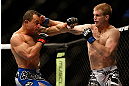LAS VEGAS, NV - FEBRUARY 02:  (R-L) Evan Dunham punches Gleison Tibau during their lightweight fight at UFC 156 on February 2, 2013 at the Mandalay Bay Events Center in Las Vegas, Nevada.  (Photo by Josh Hedges/Zuffa LLC/Zuffa LLC via Getty Images) *** Local Caption *** Gleison Tibau; Evan Dunham