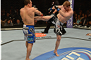 LAS VEGAS, NV - FEBRUARY 02:  (R-L) Evan Dunham kicks Gleison Tibau during their lightweight fight at UFC 156 on February 2, 2013 at the Mandalay Bay Events Center in Las Vegas, Nevada.  (Photo by Donald Miralle/Zuffa LLC/Zuffa LLC via Getty Images) *** Local Caption *** Gleison Tibau; Evan Dunham