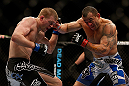 LAS VEGAS, NV - FEBRUARY 02:  (R-L) Gleison Tibau punches Evan Dunham during their lightweight fight at UFC 156 on February 2, 2013 at the Mandalay Bay Events Center in Las Vegas, Nevada.  (Photo by Josh Hedges/Zuffa LLC/Zuffa LLC via Getty Images) *** Local Caption *** Gleison Tibau; Evan Dunham