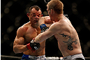 LAS VEGAS, NV - FEBRUARY 02:  (R-L) Evan Dunham elbows Gleison Tibau during their lightweight fight at UFC 156 on February 2, 2013 at the Mandalay Bay Events Center in Las Vegas, Nevada.  (Photo by Josh Hedges/Zuffa LLC/Zuffa LLC via Getty Images) *** Local Caption *** Gleison Tibau; Evan Dunham
