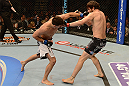 LAS VEGAS, NV - FEBRUARY 02:  (L-R) Demian Maia punches Jon Fitch during their welterweight fight at UFC 156 on February 2, 2013 at the Mandalay Bay Events Center in Las Vegas, Nevada.  (Photo by Donald Miralle/Zuffa LLC/Zuffa LLC via Getty Images) *** Local Caption *** Jon Fitch; Demian Maia