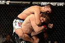LAS VEGAS, NV - FEBRUARY 02:  Demian Maia (top) attempts to submit Jon Fitch during their welterweight fight at UFC 156 on February 2, 2013 at the Mandalay Bay Events Center in Las Vegas, Nevada.  (Photo by Donald Miralle/Zuffa LLC/Zuffa LLC via Getty Images) *** Local Caption *** Jon Fitch; Demian Maia