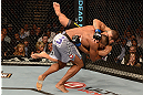 LAS VEGAS, NV - FEBRUARY 02:  Alistair Overeem (gray shorts) takes down Antonio Silva during their heavyweight fight at UFC 156 on February 2, 2013 at the Mandalay Bay Events Center in Las Vegas, Nevada.  (Photo by Donald Miralle/Zuffa LLC/Zuffa LLC via Getty Images) *** Local Caption *** Alistair Overeem; Antonio Silva