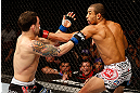 LAS VEGAS, NV - FEBRUARY 02:  (R-L) Jose Aldo punches Frankie Edgar during their featherweight title fight at UFC 156 on February 2, 2013 at the Mandalay Bay Events Center in Las Vegas, Nevada.  (Photo by Josh Hedges/Zuffa LLC/Zuffa LLC via Getty Images) *** Local Caption *** Jose Aldo; Frankie Edgar