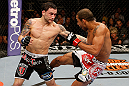 LAS VEGAS, NV - FEBRUARY 02:  (L-R) Frankie Edgar punches Jose Aldo during their featherweight title fight at UFC 156 on February 2, 2013 at the Mandalay Bay Events Center in Las Vegas, Nevada.  (Photo by Josh Hedges/Zuffa LLC/Zuffa LLC via Getty Images) *** Local Caption *** Jose Aldo; Frankie Edgar