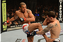LAS VEGAS, NV - FEBRUARY 02:  (L-R) Jose Aldo kicks Frankie Edgar during their featherweight title fight at UFC 156 on February 2, 2013 at the Mandalay Bay Events Center in Las Vegas, Nevada.  (Photo by Donald Miralle/Zuffa LLC/Zuffa LLC via Getty Images) *** Local Caption *** Jose Aldo; Frankie Edgar