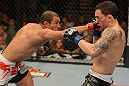 LAS VEGAS, NV - FEBRUARY 02:  (L-R) Jose Aldo punches Frankie Edgar during their featherweight title fight at UFC 156 on February 2, 2013 at the Mandalay Bay Events Center in Las Vegas, Nevada.  (Photo by Donald Miralle/Zuffa LLC/Zuffa LLC via Getty Images) *** Local Caption *** Jose Aldo; Frankie Edgar