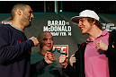 LONDON, ENGLAND - FEBRUARY 13:  (L-R) Opponents Che Mills and Matthew Riddle face off during a UFC press conference on February 13, 2013 at Hooks Gym in London, England.  (Photo by Josh Hedges/Zuffa LLC/Zuffa LLC via Getty Images)