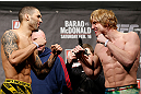LONDON, ENGLAND - FEBRUARY 15:  (L-R) Opponents Che Mills and Matthew Riddle face off during the UFC weigh-in on February 15, 2013 at Wembley Arena in London, England.  (Photo by Josh Hedges/Zuffa LLC/Zuffa LLC via Getty Images)