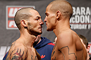 LONDON, ENGLAND - FEBRUARY 15:  (L-R) Opponents Cub Swanson and Dustin Poirier face off during the UFC weigh-in on February 15, 2013 at Wembley Arena in London, England.  (Photo by Josh Hedges/Zuffa LLC/Zuffa LLC via Getty Images)