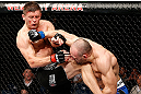 LONDON, ENGLAND - FEBRUARY 16:  (R-L) Stanislav Nedkov punches Tom Watson in their middleweight fight during the UFC on Fuel TV event on February 16, 2013 at Wembley Arena in London, England.  (Photo by Josh Hedges/Zuffa LLC/Zuffa LLC via Getty Images)