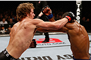 LONDON, ENGLAND - FEBRUARY 16:  (L-R) Gunnar Nelson punches Jorge Santiago in their welterweight fight during the UFC on Fuel TV event on February 16, 2013 at Wembley Arena in London, England.  (Photo by Josh Hedges/Zuffa LLC/Zuffa LLC via Getty Images)