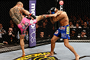 LONDON, ENGLAND - FEBRUARY 16:  (L-R) Cub Swanson kicks Dustin Poirier in their featherweight fight during the UFC on Fuel TV event on February 16, 2013 at Wembley Arena in London, England.  (Photo by Josh Hedges/Zuffa LLC/Zuffa LLC via Getty Images)