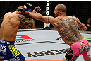 LONDON, ENGLAND - FEBRUARY 16:  (R-L) Cub Swanson punches Dustin Poirier in their featherweight fight during the UFC on Fuel TV event on February 16, 2013 at Wembley Arena in London, England.  (Photo by Josh Hedges/Zuffa LLC/Zuffa LLC via Getty Images)