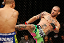 LONDON, ENGLAND - FEBRUARY 16:  (R-L) Cub Swanson kicks Dustin Poirier in their featherweight fight during the UFC on Fuel TV event on February 16, 2013 at Wembley Arena in London, England.  (Photo by Josh Hedges/Zuffa LLC/Zuffa LLC via Getty Images)
