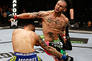LONDON, ENGLAND - FEBRUARY 16:  (R-L) Cub Swanson throws a spinning back fist against Dustin Poirier in their featherweight fight during the UFC on Fuel TV event on February 16, 2013 at Wembley Arena in London, England.  (Photo by Josh Hedges/Zuffa LLC/Zuffa LLC via Getty Images)