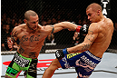 LONDON, ENGLAND - FEBRUARY 16:  (L-R) Cub Swanson punches Dustin Poirier in their featherweight fight during the UFC on Fuel TV event on February 16, 2013 at Wembley Arena in London, England.  (Photo by Josh Hedges/Zuffa LLC/Zuffa LLC via Getty Images)
