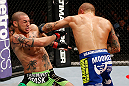 LONDON, ENGLAND - FEBRUARY 16:  (R-L) Dustin Poirier punches Cub Swanson in their featherweight fight during the UFC on Fuel TV event on February 16, 2013 at Wembley Arena in London, England.  (Photo by Josh Hedges/Zuffa LLC/Zuffa LLC via Getty Images)