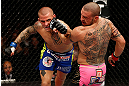 LONDON, ENGLAND - FEBRUARY 16:  (L-R) Dustin Poirier punches Cub Swanson in their featherweight fight during the UFC on Fuel TV event on February 16, 2013 at Wembley Arena in London, England.  (Photo by Josh Hedges/Zuffa LLC/Zuffa LLC via Getty Images)