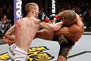 LONDON, ENGLAND - FEBRUARY 16:  (L-R) Michael McDonald punches Renan Barao in their interim bantamweight title fight during the UFC on Fuel TV event on February 16, 2013 at Wembley Arena in London, England.  (Photo by Josh Hedges/Zuffa LLC/Zuffa LLC via Getty Images)
