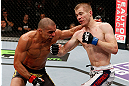 LONDON, ENGLAND - FEBRUARY 16:  (R-L) Michael McDonald punches Renan Barao in their interim bantamweight title fight during the UFC on Fuel TV event on February 16, 2013 at Wembley Arena in London, England.  (Photo by Josh Hedges/Zuffa LLC/Zuffa LLC via Getty Images)