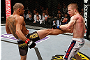 LONDON, ENGLAND - FEBRUARY 16:  (L-R) Renan Barao kicks Michael McDonald in their interim bantamweight title fight during the UFC on Fuel TV event on February 16, 2013 at Wembley Arena in London, England.  (Photo by Josh Hedges/Zuffa LLC/Zuffa LLC via Getty Images)