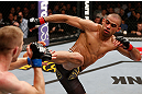 LONDON, ENGLAND - FEBRUARY 16:  (R-L) Renan Barao kicks Michael McDonald in their interim bantamweight title fight during the UFC on Fuel TV event on February 16, 2013 at Wembley Arena in London, England.  (Photo by Josh Hedges/Zuffa LLC/Zuffa LLC via Getty Images)