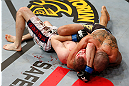 LONDON, ENGLAND - FEBRUARY 16:  (R-L) Renan Barao secures an arm triangle choke submission to defeat Michael McDonald in their interim bantamweight title fight during the UFC on Fuel TV event on February 16, 2013 at Wembley Arena in London, England.  (Photo by Josh Hedges/Zuffa LLC/Zuffa LLC via Getty Images)