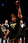 LONDON, ENGLAND - FEBRUARY 16:  Renan Barao reacts after defeating Michael McDonald in their interim bantamweight title fight during the UFC on Fuel TV event on February 16, 2013 at Wembley Arena in London, England.  (Photo by Josh Hedges/Zuffa LLC/Zuffa LLC via Getty Images)