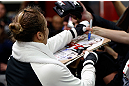TORRANCE, CA - FEBRUARY 20:  Ronda Rousey signs autographs after an open training session for fans and media at the UFC Gym on February 20, 2013 in Torrance, California.  (Photo by Josh Hedges/Zuffa LLC/Zuffa LLC via Getty Images)