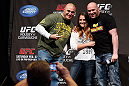 ANAHEIM, CA - FEBRUARY 22:  UFC President Dana White poses for photos with fans during a Q&amp;A session before the UFC 157 weigh-in at Honda Center on February 22, 2013 in Anaheim, California.  (Photo by Josh Hedges/Zuffa LLC/Zuffa LLC via Getty Images)