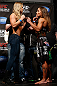 ANAHEIM, CA - FEBRUARY 22:  (L-R) Opponents Ronda Rousey and Liz Carmouche face off during the UFC 157 weigh-in at Honda Center on February 22, 2013 in Anaheim, California.  (Photo by Josh Hedges/Zuffa LLC/Zuffa LLC via Getty Images)