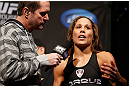 ANAHEIM, CA - FEBRUARY 22:  (R-L) Liz Carmouche is interviewed by Mike Goldberg during the UFC 157 weigh-in at Honda Center on February 22, 2013 in Anaheim, California.  (Photo by Josh Hedges/Zuffa LLC/Zuffa LLC via Getty Images)