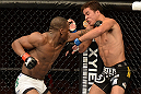 ANAHEIM, CA - FEBRUARY 23:  (L-R) Nah-Shon Burrell punches Yuri Villefort in their welterweight bout during UFC 157 at Honda Center on February 23, 2013 in Anaheim, California.  (Photo by Donald Miralle/Zuffa LLC/Zuffa LLC via Getty Images) *** Local Caption *** Nah-Shon Burrell; Yuri Villefort