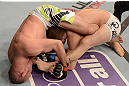 ANAHEIM, CA - FEBRUARY 23:  Kenny Robertson (left) attempts to submit Brock Jardine in their welterweight bout during UFC 157 at Honda Center on February 23, 2013 in Anaheim, California.  (Photo by Donald Miralle/Zuffa LLC/Zuffa LLC via Getty Images) *** Local Caption *** Kenny Robertson; Brock Jardine