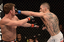 ANAHEIM, CA - FEBRUARY 23:  (R-L) Caros Fodor punches Sam Stout in their lightweight bout during UFC 157 at Honda Center on February 23, 2013 in Anaheim, California.  (Photo by Donald Miralle/Zuffa LLC/Zuffa LLC via Getty Images) *** Local Caption *** Sam Stout; Caros Fodor