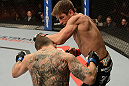 ANAHEIM, CA - FEBRUARY 23:  Sam Stout (right) punches Caros Fodor in their lightweight bout during UFC 157 at Honda Center on February 23, 2013 in Anaheim, California.  (Photo by Donald Miralle/Zuffa LLC/Zuffa LLC via Getty Images) *** Local Caption *** Sam Stout; Caros Fodor