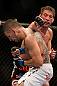 ANAHEIM, CA - FEBRUARY 23:  (R-L) Sam Stout punches Caros Fodor in their lightweight bout during UFC 157 at Honda Center on February 23, 2013 in Anaheim, California.  (Photo by Josh Hedges/Zuffa LLC/Zuffa LLC via Getty Images) *** Local Caption *** Sam Stout; Caros Fodor