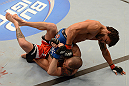 ANAHEIM, CA - FEBRUARY 23:  Dennis Bermudez (top) punches Matt Grice in their featherweight bout during UFC 157 at Honda Center on February 23, 2013 in Anaheim, California.  (Photo by Donald Miralle/Zuffa LLC/Zuffa LLC via Getty Images) *** Local Caption *** Dennis Bermudez; Matt Grice