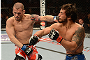 ANAHEIM, CA - FEBRUARY 23:  (R-L) Dennis Bermudez punches Matt Grice in their featherweight bout during UFC 157 at Honda Center on February 23, 2013 in Anaheim, California.  (Photo by Donald Miralle/Zuffa LLC/Zuffa LLC via Getty Images) *** Local Caption *** Dennis Bermudez; Matt Grice