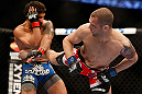 ANAHEIM, CA - FEBRUARY 23:  Matt Grice (right) kicks Dennis Bermudez in their featherweight bout during UFC 157 at Honda Center on February 23, 2013 in Anaheim, California.  (Photo by Josh Hedges/Zuffa LLC/Zuffa LLC via Getty Images) *** Local Caption *** Dennis Bermudez; Matt Grice