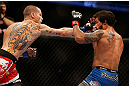 ANAHEIM, CA - FEBRUARY 23:  Matt Grice (left) punches Dennis Bermudez in their featherweight bout during UFC 157 at Honda Center on February 23, 2013 in Anaheim, California.  (Photo by Josh Hedges/Zuffa LLC/Zuffa LLC via Getty Images) *** Local Caption *** Dennis Bermudez; Matt Grice