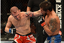 ANAHEIM, CA - FEBRUARY 23:  (L-R) Matt Grice punches Dennis Bermudez in their featherweight bout during UFC 157 at Honda Center on February 23, 2013 in Anaheim, California.  (Photo by Donald Miralle/Zuffa LLC/Zuffa LLC via Getty Images) *** Local Caption *** Dennis Bermudez; Matt Grice
