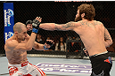 ANAHEIM, CA - FEBRUARY 23:  (R-L) Michael Chiesa punches Anton Kuivanen in their lightweight bout during UFC 157 at Honda Center on February 23, 2013 in Anaheim, California.  (Photo by Donald Miralle/Zuffa LLC/Zuffa LLC via Getty Images) *** Local Caption *** Michael Chiesa; Anton Kuivanen
