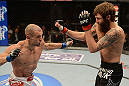 ANAHEIM, CA - FEBRUARY 23:  (L-R) Anton Kuivanen punches Michael Chiesa in their lightweight bout during UFC 157 at Honda Center on February 23, 2013 in Anaheim, California.  (Photo by Donald Miralle/Zuffa LLC/Zuffa LLC via Getty Images) *** Local Caption *** Michael Chiesa; Anton Kuivanen
