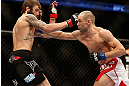ANAHEIM, CA - FEBRUARY 23:  (R-L) Anton Kuivanen punches Michael Chiesa in their lightweight bout during UFC 157 at Honda Center on February 23, 2013 in Anaheim, California.  (Photo by Josh Hedges/Zuffa LLC/Zuffa LLC via Getty Images) *** Local Caption *** Michael Chiesa; Anton Kuivanen