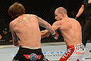 ANAHEIM, CA - FEBRUARY 23:  (R-L) Anton Kuivanen punches Michael Chiesa in their lightweight bout during UFC 157 at Honda Center on February 23, 2013 in Anaheim, California.  (Photo by Donald Miralle/Zuffa LLC/Zuffa LLC via Getty Images) *** Local Caption *** Michael Chiesa; Anton Kuivanen