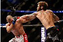 ANAHEIM, CA - FEBRUARY 23:  (R-L) Michael Chiesa punches Anton Kuivanen in their lightweight bout during UFC 157 at Honda Center on February 23, 2013 in Anaheim, California.  (Photo by Josh Hedges/Zuffa LLC/Zuffa LLC via Getty Images) *** Local Caption *** Michael Chiesa; Anton Kuivanen