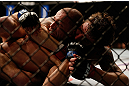 ANAHEIM, CA - FEBRUARY 23:  (R-L) Michael Chiesa attempts to submit Anton Kuivanen in their lightweight bout during UFC 157 at Honda Center on February 23, 2013 in Anaheim, California.  (Photo by Josh Hedges/Zuffa LLC/Zuffa LLC via Getty Images) *** Local Caption *** Michael Chiesa; Anton Kuivanen