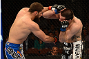 ANAHEIM, CA - FEBRUARY 23:  (L-R) Court McGee punches Josh Neer in their welterweight bout during UFC 157 at Honda Center on February 23, 2013 in Anaheim, California.  (Photo by Donald Miralle/Zuffa LLC/Zuffa LLC via Getty Images) *** Local Caption *** Court McGee; Josh Neer